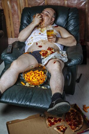 136666497-fat-couch-potato-eating-a-huge-hamburger-and-watching-television-harsh-lighting-from...jpg