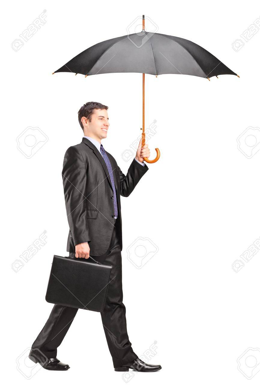 16392100-full-length-portrait-of-a-man-holding-an-umbrella-and-briefcase-isolated-on-white-bac...jpg