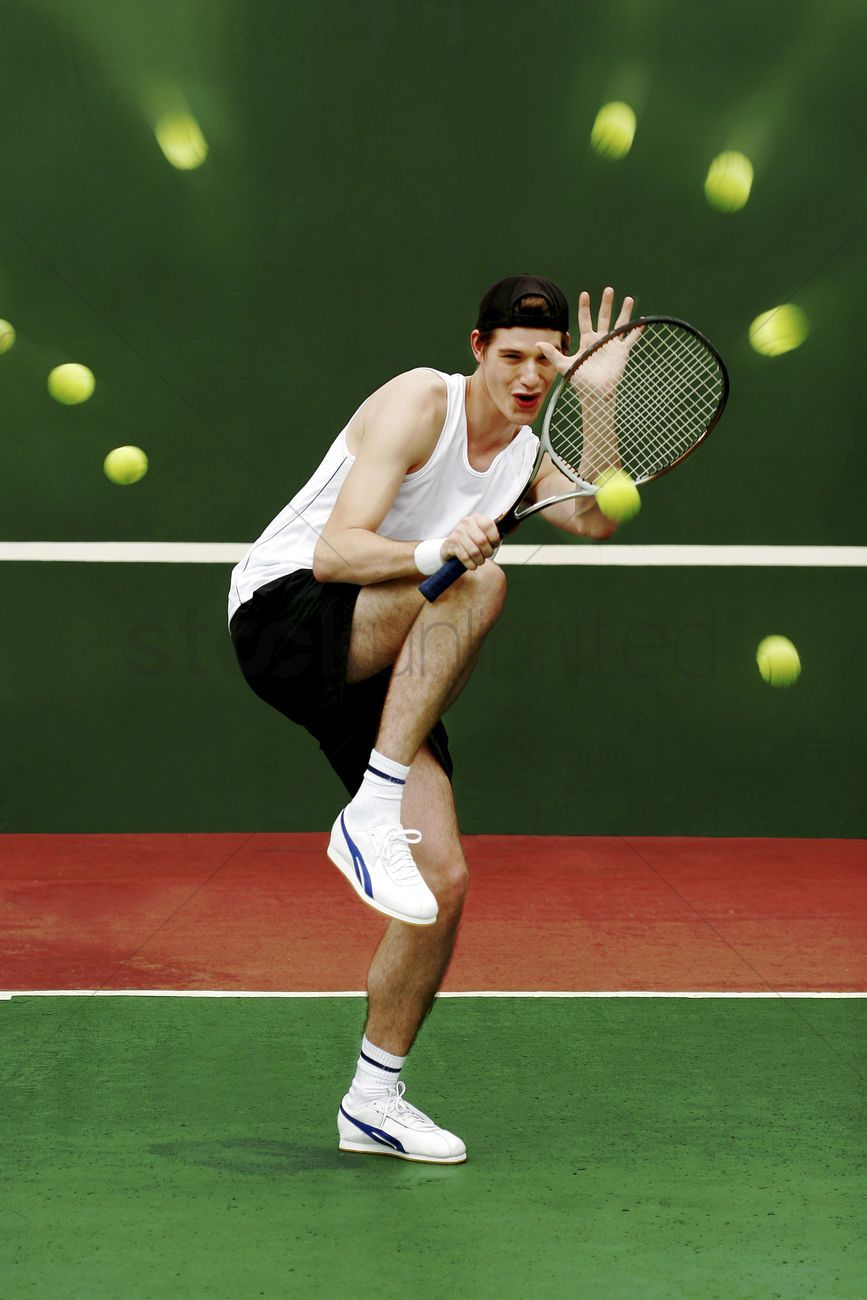 a-man-using-his-tennis-racquet-to-defend-himself-from-being-hit-by-the-tennis-balls_1671697.jpg