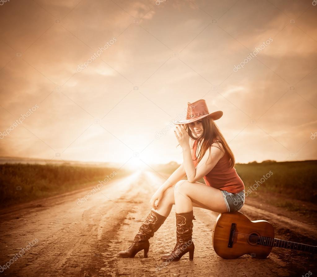 depositphotos_47120377-stock-photo-stylish-cowgirl-on-a-sunset.jpg