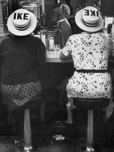 ed-clark-ladies-eating-lunch-and-displaying-hats-that-support-ike.jpg