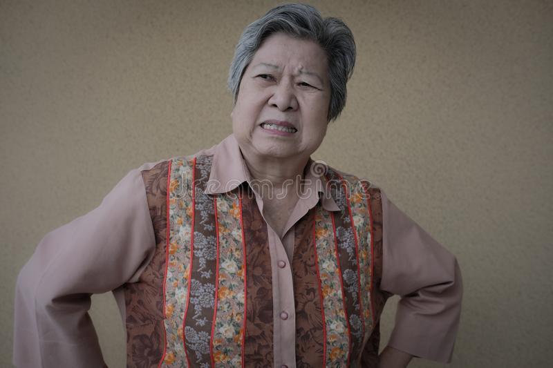 furious-elder-woman-enraged-elderly-female-angry-asian-senior-portrait-furious-elder-woman-enr...jpg