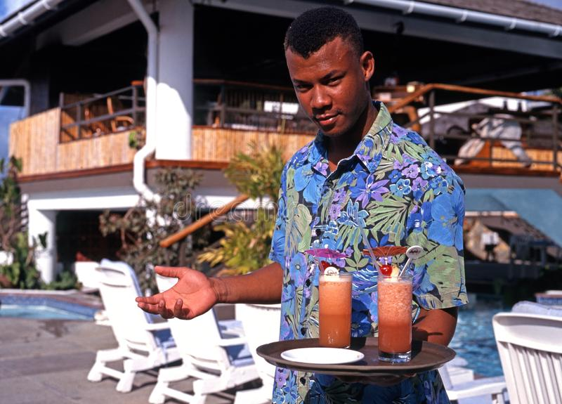 hotel-waiter-tobago-holding-tray-cocktails-grafton-beach-resort-stonehaven-bay-61290958.jpg