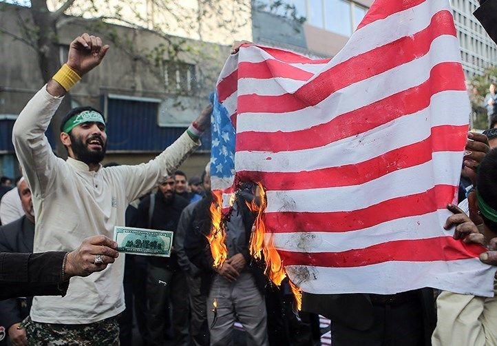 Iranian_Protesters_Burning_USA_Flag.jpg