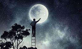 men-get-moon-businessman-ladder-trying-to-reach-sky-91598249.jpg