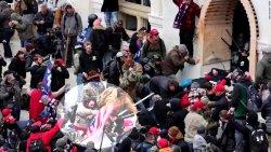 210110210555-capitol-riot-officer-beating-american-flag-super-tease.jpg